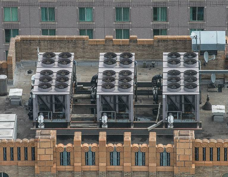 Large HVAC Unit on a commercial building representing industrial adhesives for the building and construction industry from H.B. Fuller.